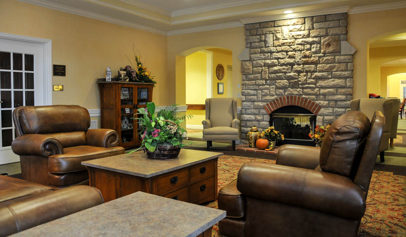 A beautiful fireplace welcomes residents into this retirement home.